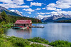 The Maligne Lake boathouse with reflection on Maligne Lake, Jasper National Park, Alberta, Canada.