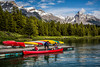 Colorful canoes at the dock at the Maligne Lake boat dock in Jasper National Park, Alberta, Canada.