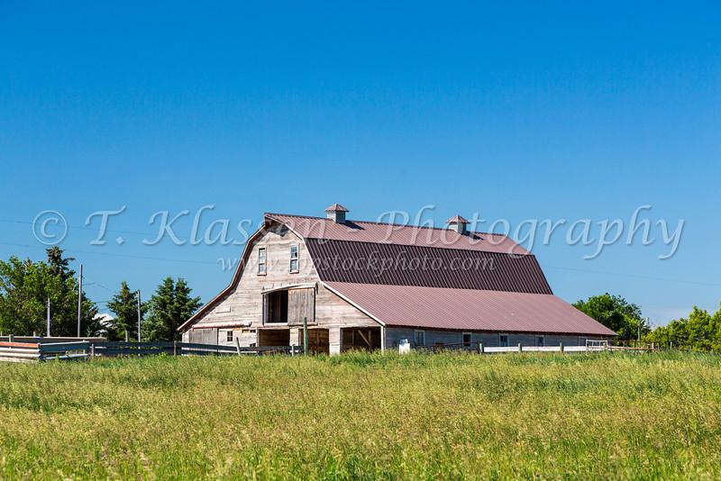 A large farm barn in the countryside near Nanton, Alberta, Canada.