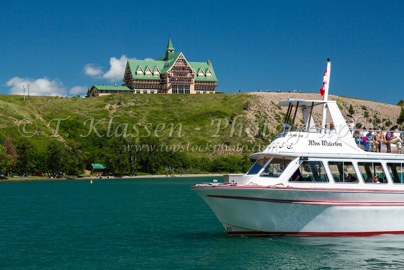 A tour boat and the Prince of Wales Hotel overlooking Upper Waterton Lake in Waterton Lakes National Park, Alberta, Canada.