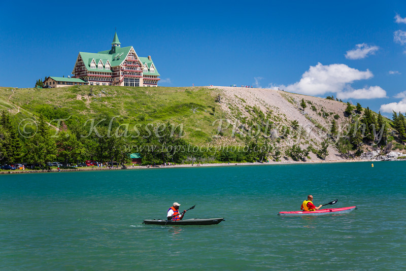 Kayakers and the Prince of Wales Hotel overlooking Upper Waterton Lake in Waterton Lakes National Park, Alberta, Canada.