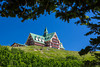 The Prince of Wales Hotel overlooking Upper Waterton Lake in Waterton Lakes National Park, Alberta, Canada.