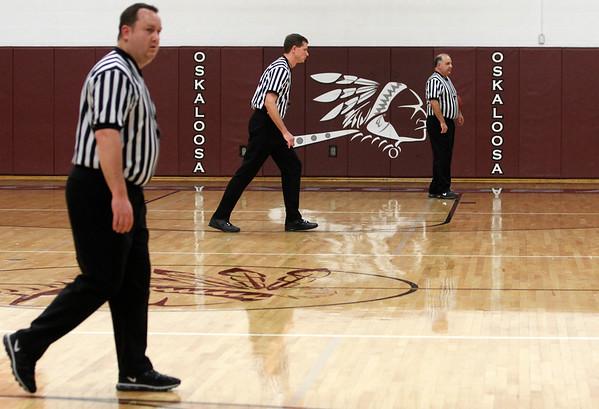 RACHEL LEATHE/ THE COURIER<br /> <br /> 022316 Class 2A District Boys Basketball, Albia vs. Pella Christian at Oskaloosa High School Gymnasium Tuesday evening