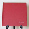 Red Album Cover.<br /> Notice the embossed name of the Bride and Groom at the bottom corner.