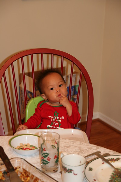 Nicholas in his booster at Christmas breakfast.