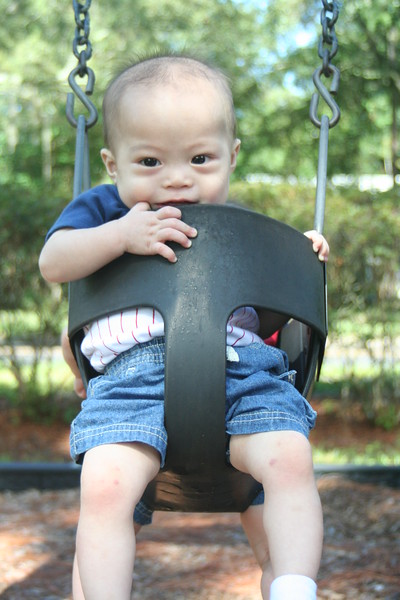 Matthew in the swing, using all his 5 senses.  :P