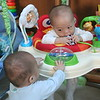 Bouncing away!  (Nicholas in bouncer, Matthew outside.)