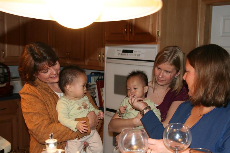 Nicholas sampling the turkey.  (Left to right: Aunt Bobbi, Matthew, Nicholas, Cousin Rachel, Shannon)