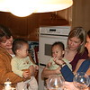 Nicholas sampling the turkey.  (Left to right: Aunt Bobbi, Matthew, Nicholas, Cousin Rachel, Shannon)