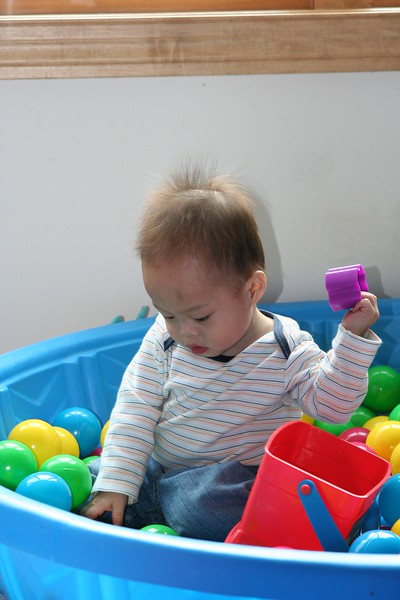 Nicholas exploring the pool.