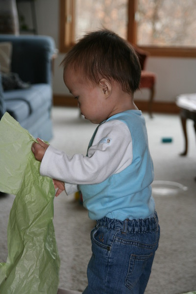 Matthew playing with tissue paper.