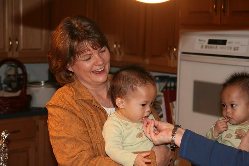 Matthew sampling the Turkey with his Great Aunt Bobbi.