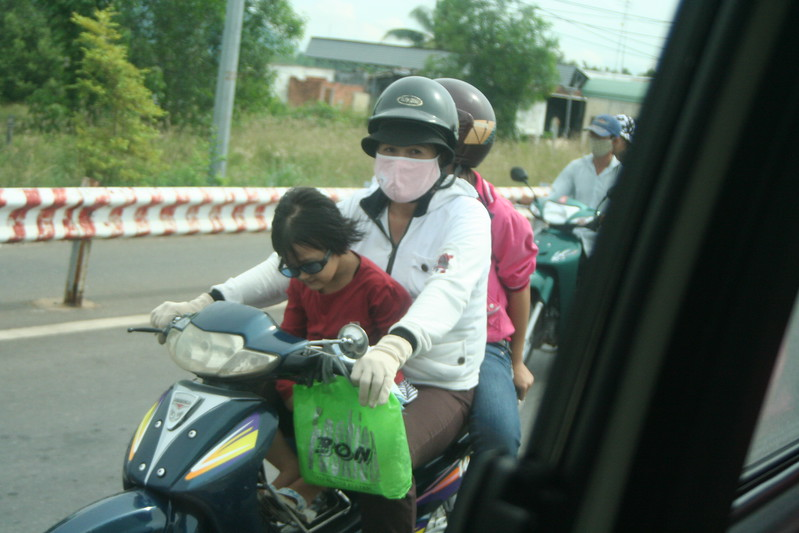 Girl Sleeping on a Motorbike