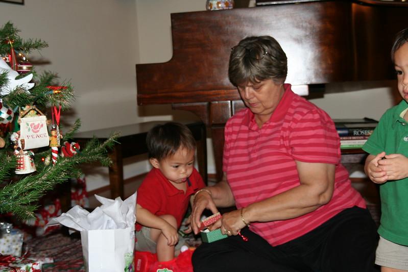 Matthew helping open a gift