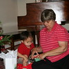 Matthew helping open a gift