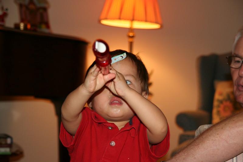 Matthew examining a recorder