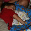 Matthew playing with his new blanket and pillow set