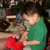 Nicholas opening a gift