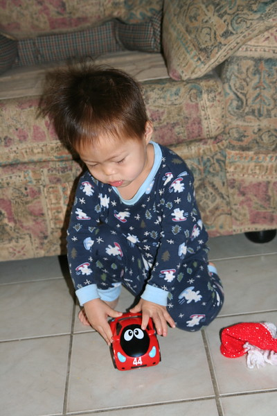 Matthew figuring out his race car.