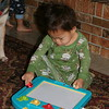 Nicholas playing with his new magnadoodle.