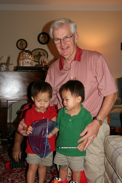 """Matthew, Nicholas and their Grandpoppy opening a """"gift"""""""