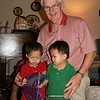 "Matthew, Nicholas and their Grandpoppy opening a ""gift"""
