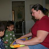 Matthew, Nicholas and Mommy playing with a water sketch board