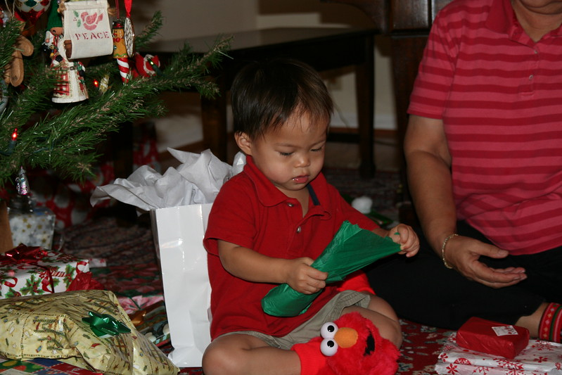 Matthew opening a gift
