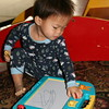 Matthew playing with the magnadoodle.