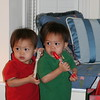 Matthew and Nicholas playing with their music kit