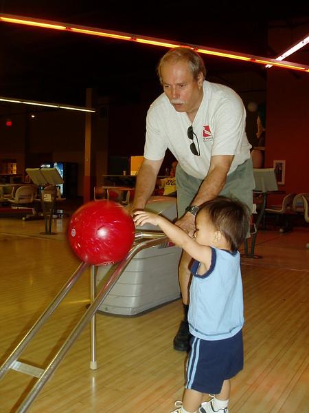 Nicholas giving Grandpa a bowling lesson.