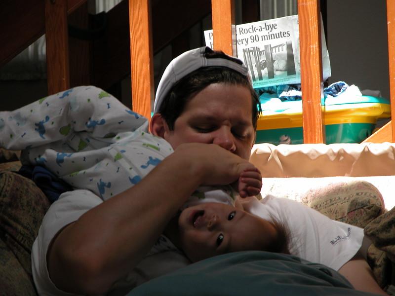 Nicholas wrestling with Daddy.