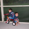 Sharing the tricycle.