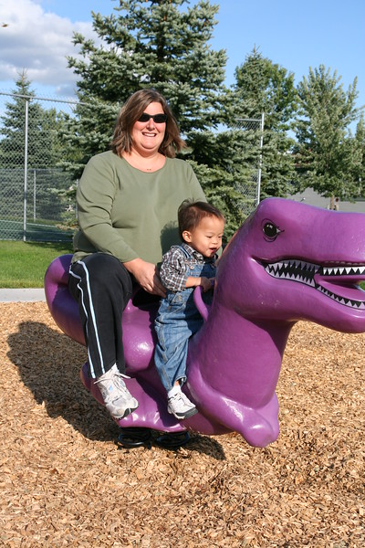 Matthew and his mommy on a Barneysaurus Rex!