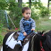 Matthew on the pony.