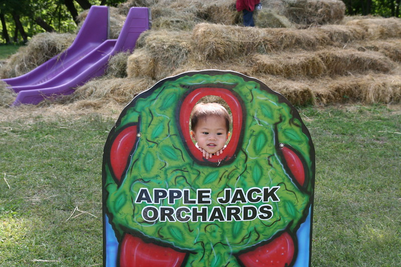 Second day at the orchard for Nicholas.  (Again, his mom was holding him up.)