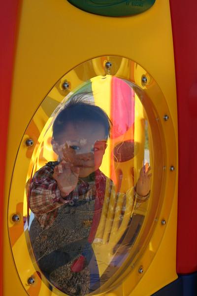 Nicholas hamming it up at the playground.