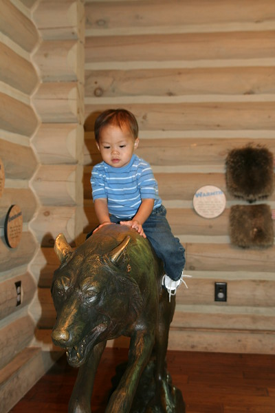 Matthew riding the wolf.
