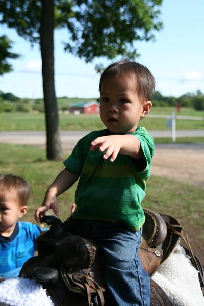 Nicholas on a saddle.
