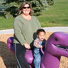 Nicholas and his mommy on a Barneysaurus Rex!