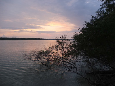 Handeleum island with sunset over Ujung Kulon peninsula