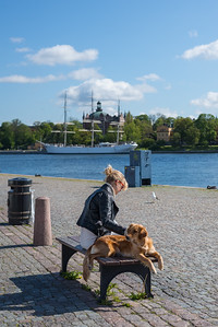 Woman and a dog on a quay, Stockholm, May 2015
