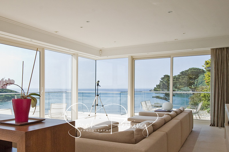 A Luxury sitting room with a view of the water