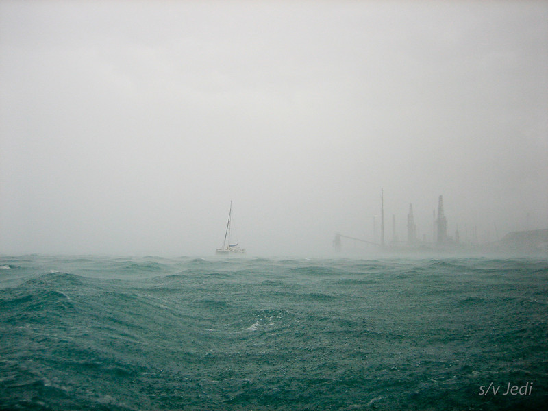 IMG_1022.jpg<br /> Cruising Aruba.<br /> Look at that... another boat coming in just as the storm unleashes itself.
