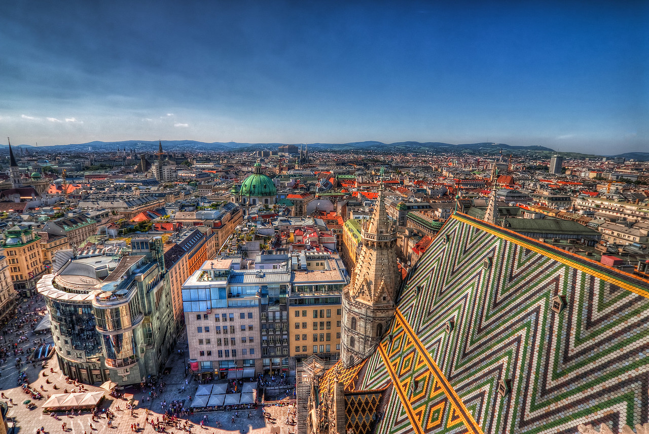 On top of Vienna  This photo was taken from the tower of the Stephens Church in Vienna. The stairs up to the top were quite a challenge, but I think the view was quite worth it :). This photo was taken sometime in August last year, during a very sunny day.  HDR from three shots, taken with Canon 450D with Sigma 10-20mm lens, handheld.