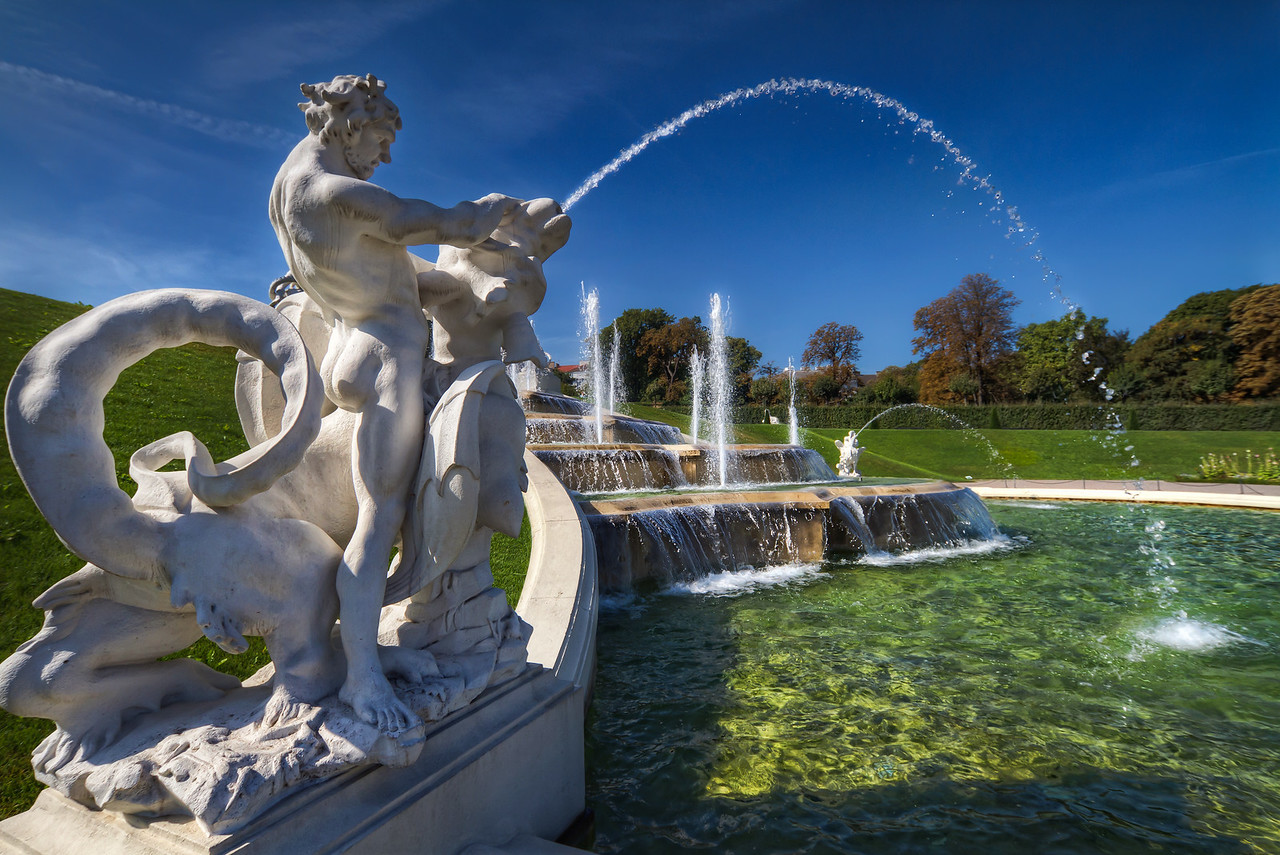 Taming the Dragon  Or I think the fountain looks like one :). This is one of the fountains in the gardens of the Belvedere Palace in Vienna.  HDR from three shots, taken with Canon 7D with Sigma 10-20mm lens, handheld.