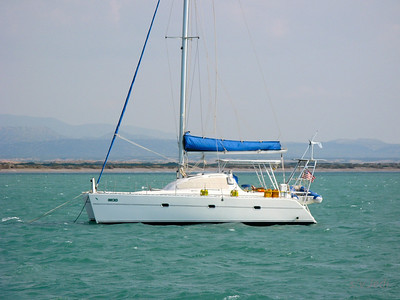 IMG_1143.JPG Cruising Colombia: Bahia Honda Gecko at anchor with 30 kts of wind. The savannah in the background.