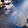 Local Farrier shoeing a horse, the smoke rises from the red hot metal as he seats the shoe, before cooling it in water