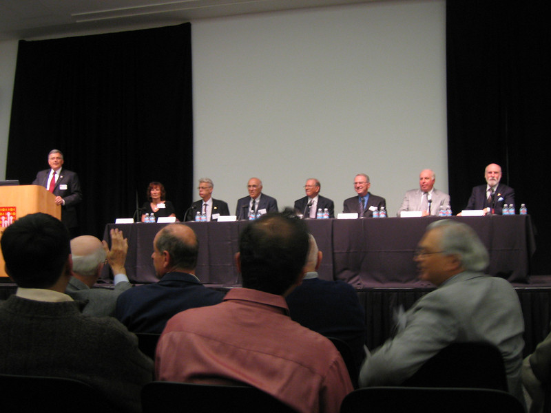 The panel, and 1977 affiliations, from left to right: Virginia Strazisar Travers (BBN), Paal Spilling (Norwegian Defense Research), Don Nielson (SRI), Bob Kahn (DARPA), Irwin Jacobs (Linkabit), Jim Garrett (Collins Radio Co.), Vint Cerf (DARPA)