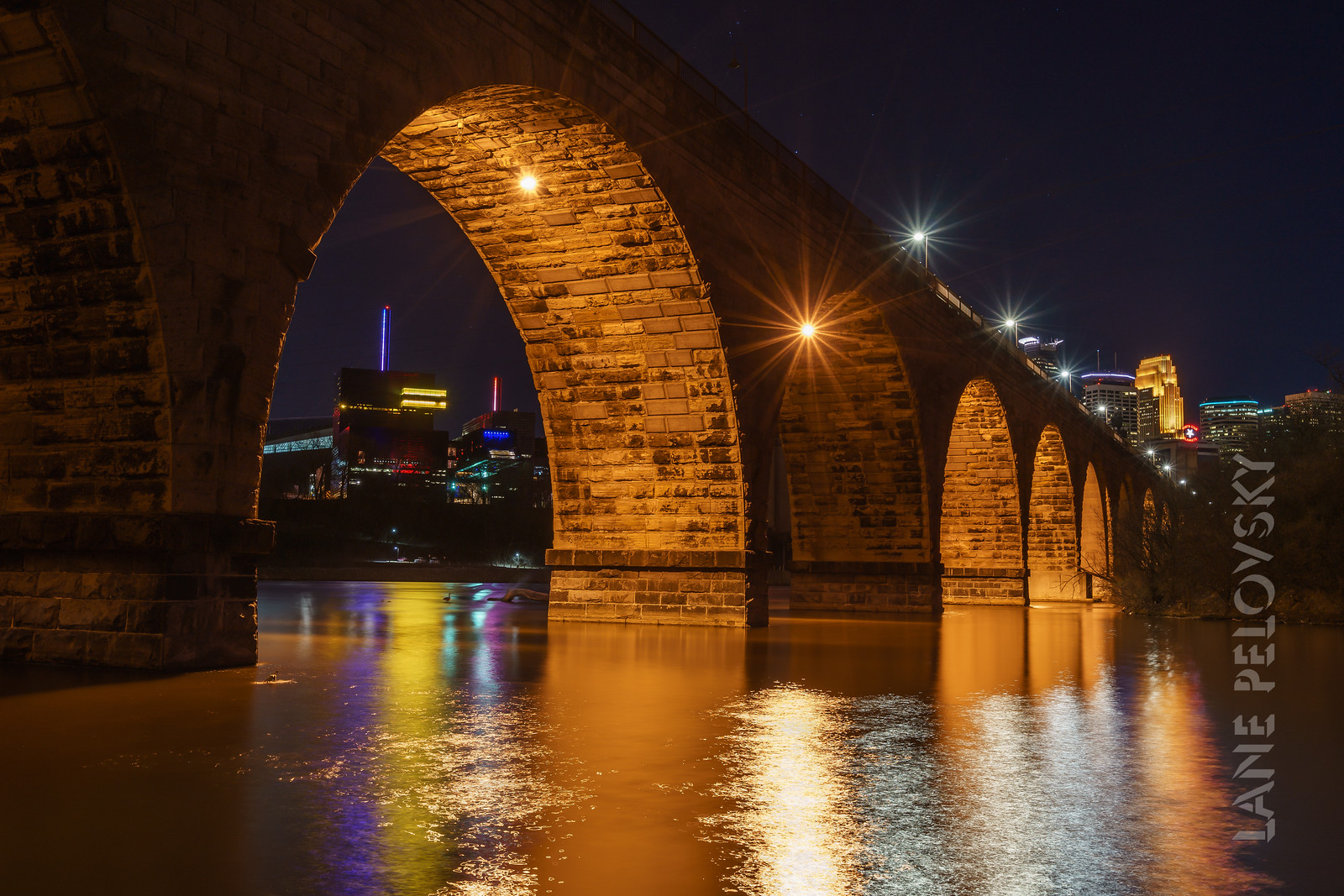 Mississippi Water's Edge, Stone Arch Bridge, and Minneapolis Skyline